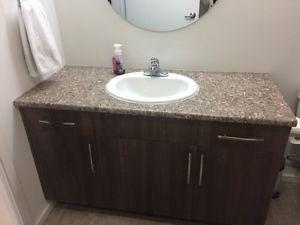 Bathroom vanity with counter top sink and faucet