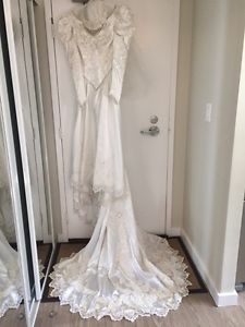 Beautiful Wedding Dress by Mon Cheri Bridals Inc
