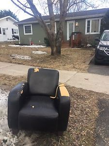 Free club chair. Arm peeling, needs cover.