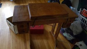 Singer sewing machine in fold down table