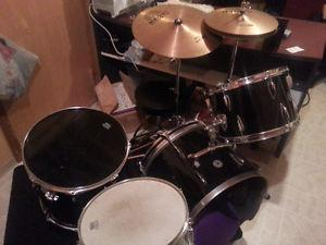 Six piece drum set (4 drums, 2 cymbals) with a seat.