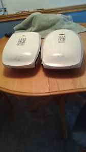 TWO GEORGE FOREMAN LEAN MEAN FAT GRILLING MACHINES
