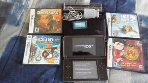 Nintendo DSi XL with docking charger, case and games