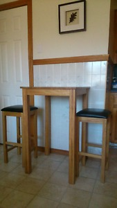 Oak table and two stools