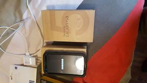 Samsung galaxy S5 with charging cable and otter box case!