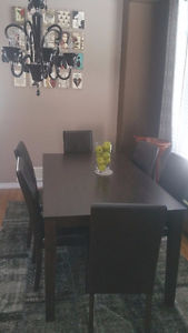 Solid wood dining table and 6 chairs - new