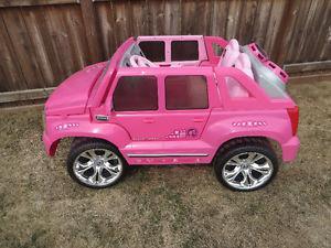 pink cadillac escalade electric car