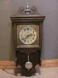 Electric clock 30 inches long x 5 x 10 inches wide $27