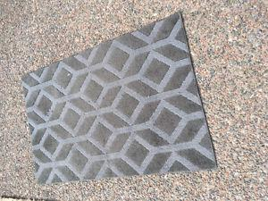 Grey rug with rubber backing