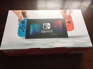 Nintendo Switch- New, unopened RED/BLUE