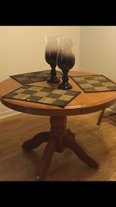 Solid wood dining room table with leaf