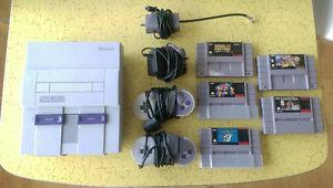 Super Nintendo console, controllers and 5 games