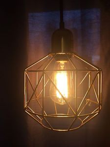 Hanging pendant lamp with cage bulb