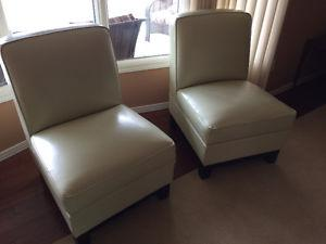 Two leather slipper chairs- like new!