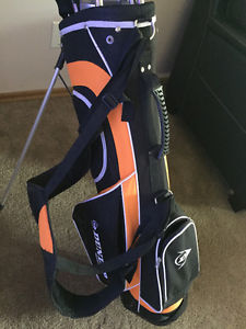 Dunlop golf clubs with bag, stand, covers. Used once.