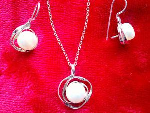 Beautiful Sterling Silver pendant and earrings