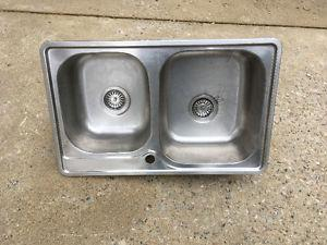 Stainless sink and a half.