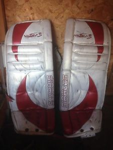 """29"""" white and red Simmons goalie pads"""