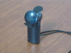 Little Battery Operated Hand Fan.