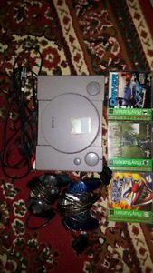 Playstation 1 with games and controllers