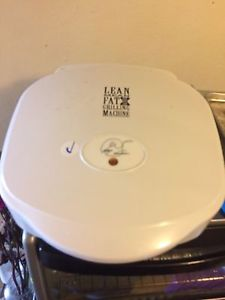Lean mean fat grilling machine