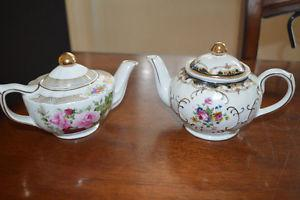 Two original Adeline teapots with gold trim.