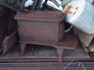 cast iron space heater ornate legs lawn yard ornament