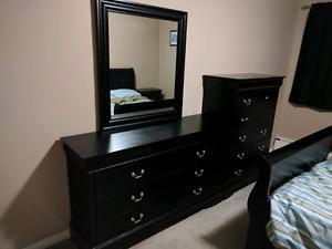 Bedroom dresser, nightstand, and sleigh bed set