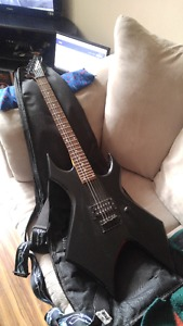 Black Electric Guitar, Amplifier and Foot Pedal