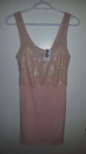 Brand new (tags on) pink sequined dress from Envy