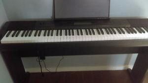 Casio Electric Piano with Weighted Keys.