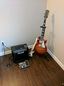 Epiphone Les Paul, marshal amp and fx pedal.