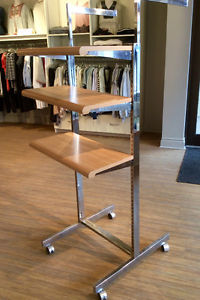 Retail fixtures - two sided rolling shelving (w/extra