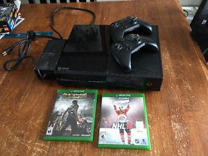 Xbox one with two games and controllers