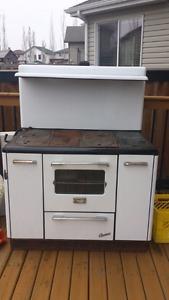 Acme antique wood stove