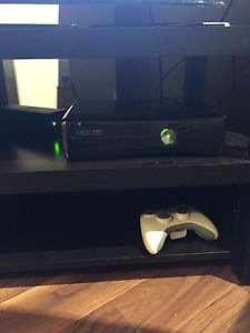 Black XBOX 360 with 12 games and 3 controllers