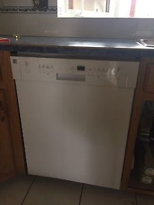 Kenmore dishwasher and range. Samsung microwave.