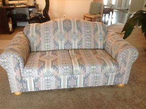 Matching Camel-Back Sofa and Love Seat