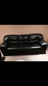 Black leather sofa and loveseat