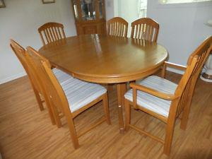 Oak Dining Room Table (with three leaves) and six chairs -