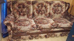 Older style couch, great for a camp.
