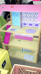 Barbie house with barbies and accessories