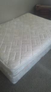 King size bed with topper and box spring.