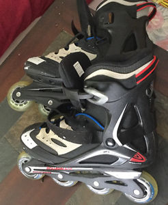 Men's size 9 roller blades like new