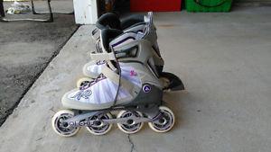 Large wheels women's roller blades.