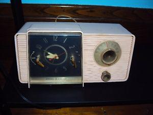 Antique General Electric pink radio and clock, 60 cycle