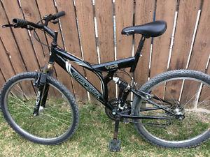 Supercycle 21 speed mountain bike, (26 Inch tires)