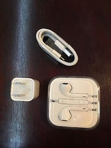 Brand new and Unused Earpods and Charger (from 6S)