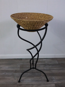 Wicker basket on wrought iron stand