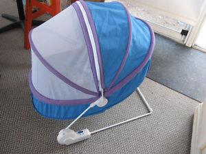 baby chair with netting on top.